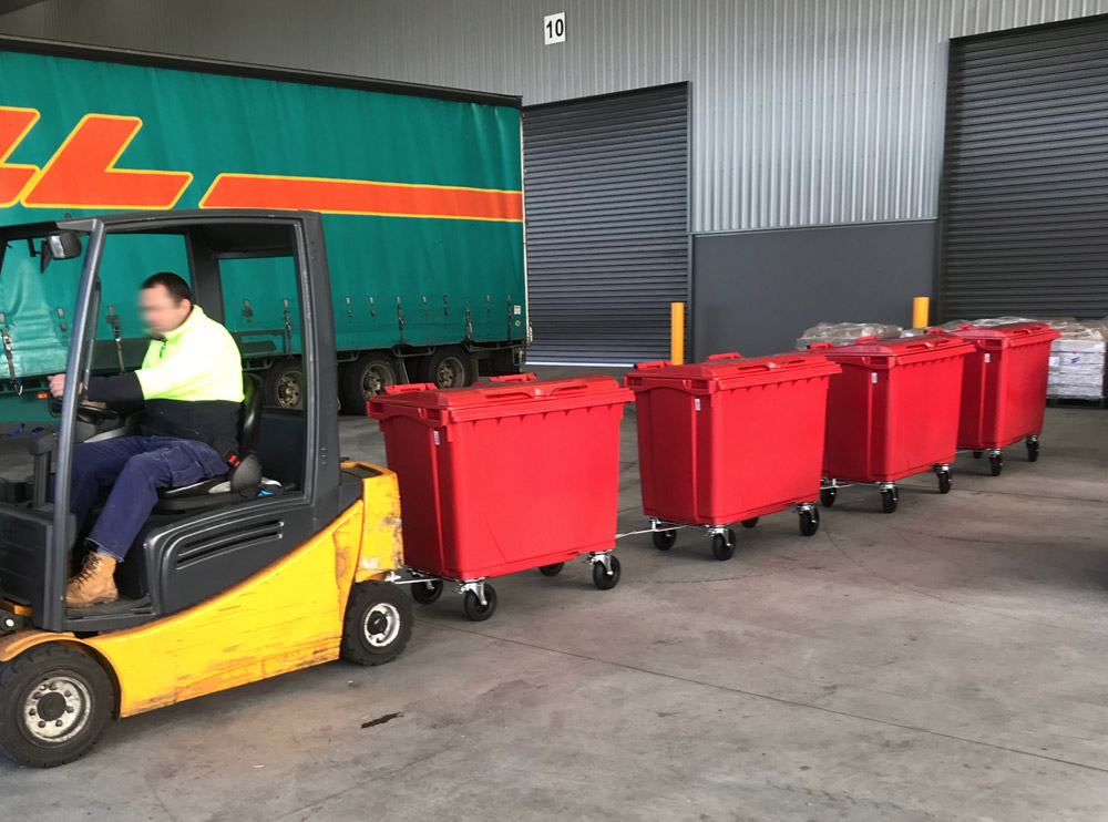 Daisy Chain 660L Plastic Bins and pull Bins behind by a Forklift